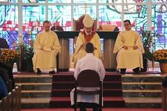 David sitting before altar and bishop