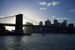 Twilight (Rafakoy) Tags: city nyc bridge sunset urban ny newyork color water brooklyn mediumformat river twilight downtown cityscape dusk manhattan skylight dumbo scan negative brooklynbridge eastriver 6x9 90mm portra c41 160nc kodakportra160nc 9x6 gw690iii fujinon90mmf35 epsonv600