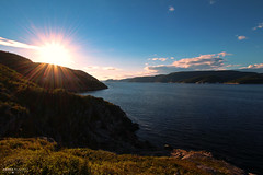 Baie Sainte Catherine - Saguenay River (Québec, Canada) (Andrea Moscato) Tags: andreamoscato canada america river fiume water freshwater sunset sun sunshine ray shadow light montagna mountain view vista vivid overlook landscape paesaggio nature natura nuvole natural naturale national np nationalpark sky cielo clouds blue green coast fiordo grass