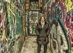 Karen (Paul B0udreau) Tags: building canada lamp layer niagara ontario paulboudreauphotography stcatharines structure winter graffiti alley alleyway nikkor1855mm photoshop d5100 nikon nikond5100 raw woman doorway