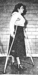 reh07-1 - Polio Walk (jackcast2015) Tags: handicapped disabledwoman crippledwoman wheelchair paralysed poliogirl legbraces calipers polio