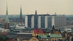 Church towers and Htorgshusen (skumroffe) Tags: roof building church skyline view sweden stockholm sdermalm churchtower utsikt tak kyrka htorgsskraporna sdersjukhuset byggnad kyrktorn htorgshusen