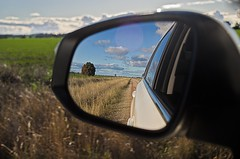 Reflection (mblaeck) Tags: travel reflection car mirror driving outdoor bluesky journey toyota sidemirror lookingback kluger carmirror toyotakluger