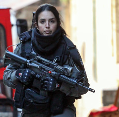 """"""" That which hath been is that which shall be, and that which hath been done is that which shall be done; and there is nothing new under the sun."""" (ybiberman) Tags: israel jerusalem oldcity alquds girl woman portrait soldier gun m16 candid streetphotography"""