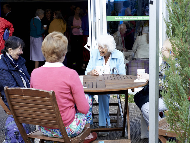 Women laughing at a coffee morning