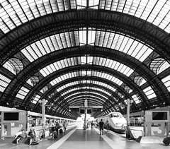 Leaving Milan (Bunaro) Tags: summer italy white black milan station architecture train tren hall europe milano curves central trainstation pillars centrale monochorome yokfeed
