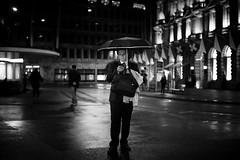 night scene (Cem Bayir) Tags: street leica people urban blackandwhite bw man monochrome rain mobile night umbrella dark handy 50mm lights switzerland phone f14 m business smartphone pre zürich summilux asph bahnhofstrasse 240 paradeplatz asperical leicam240