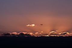 Fly into the Sunset (Richard Mart1n) Tags: abstract nikon d5000 art travel landscape landscapes sunset sun clouds cloudscape