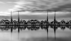 Dramatically Calm... (Aleem Yousaf) Tags: dramatically calm royal docks east london wideangle sky clouds morning cranes marina waterfront reflections 1835mm nikon d800 photo walk outdoor water long exposure neutral density filter lee big stopper monochrome blackandwhite