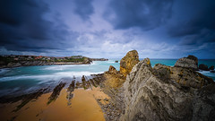 Gathering storm (TanzPanorama) Tags: coast rock rockformation bayofbiscay bay cove sea sky spain cantabria cantabriansea costacantabrica costaquebrada tanzpanorama sonya7ii sonyilce7m2 fe1635mmf4zaoss sel1635z wideangle le travel tourism ng liencres seascape waterscape storm beach