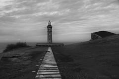 the lighthouse that survived a volcano eruption (lunaryuna) Tags: portugal azores azoresislands ilhasazuais faialisland ilhadofaial capelo coast lighthouse derelictlighthouse stillstanding capelinhosvolcano eruption survivor seascape atlanticocean landscape destruction blackwhite bw monochrome lunaryuna