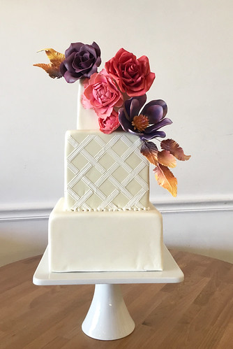 Bold Sugar Flowers and Feathers Square Wedding Cake