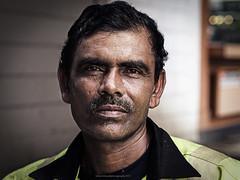Construction Employee (GilbertChuaCS) Tags: people employee street construction kualalumpur mzuiko45mm18 olympus malaysia bukit bintang portrait