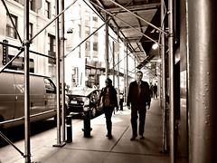 Two People and A Fire Hydrant (sjnnyny) Tags: street lines metal downtown cityscape manhattan structure lowermanhattan sidwalk officeworkers fidi stevenj coolpixp7700 sjnnyny sidewalkbridgescaffolding