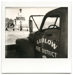 ludlow fire district. ludlow, ca. 2014. (eyetwist) Tags: california bw white black hot west abandoned film monochrome sign analog america truck project polaroid fire typography mono blackwhite route66 desert image trucker district rusty sunburned dry motel ishootfilm 66 ludlow firetruck route faded american mojave signage integral type pro instant americana trucks interstate 40 analogue spectra vacancy derelict arid decayed i40 mojavedesert impossible pz typographic motherroad eyetwist sooc firedistrict polaroidspectrapro eyetwistkevinballuff impossibleproject americantypology signgeeks impossiblebwspectra