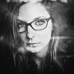 Fenêtre sur cour (Christine Lebrasseur) Tags: portrait people blackandwhite woman france art 6x6 canon glasses teenager fr onblack throughwindow gironde 500x500 léane saintloubes allrightsreservedchristinelebrasseur
