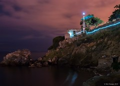 Lighthouse spirit (Nick Panagou) Tags: longexposure light sea sky seascape lightpainting reflection water rock night clouds contrast landscape rocks colours outdoor dramatic artificial greece trail greatphotographers thessaly nightonearth superphotographer silhouettesshadows bestshotoftheday magnesia canon400d bestphotographer spiritofphotography canonefs1855mmf3556isii cloudsstormssunsetssunrises