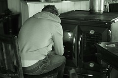 Keeping warm (norm.edwards) Tags: wood hot cold log hands warm sitting oven stove burner autumnal clamping