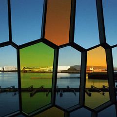 Fenestrated (Arni J.M.) Tags: houses windows sky building water glass architecture iceland ship harbour hill reykjavik hexagons sland fenestrated harpaconcerthall