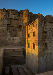 the tower knows as the ka'bah of zoroaster in naqsh-e rustam necropolis, Fars Province, Shiraz, Iran (Eric Lafforgue) Tags: sunset sculpture cliff sunlight mountain building art heritage history tourism grave rock vertical architecture outdoors temple photography persian site ancient day iran antique religion tomb middleeast culture craft persia nobody nopeople landmark historic unescoworldheritagesite relief cube shiraz orient archaeological archeology necropolis perseus antiquity zoroastrianism achaemenid kabah darius zoroastrian rockcut traveldestinations persiangulfstates royaltombs  oldruin  17138 colourimage  iro thepleiades iranianculture naqsherustam  naqsherostam farsprovince westernasia
