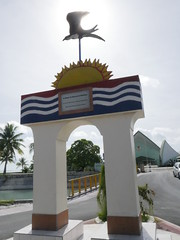 Infront of the Kiribati Parliament. The colours in their flag is the same as on the statue.