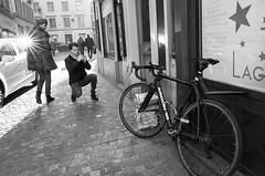 Photographers are kinda....weird (Ivan Rigamonti) Tags: zurich monochrome photographer bike