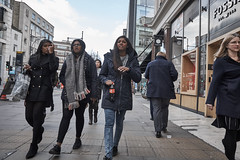 20170111T13-20-24Z-DSCF1140 (fitzrovialitter) Tags: fitzrovialitter westminster london urban street environment streetphotography westend peterfoster documentary fuji x70 fujifilm captureone geosetter exiftool geotagged england gbr oxfordcircus unitedkingdom westendward geo:lat=5151465200 geo:lon=014652000 girl jeans three girls winter walking together cold scarf explore explored
