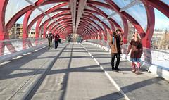 Peace Bridge (Sherlock77 (James)) Tags: calgary peacebridge bowriver streetphotography people man woman