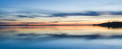 Sunset lake view (hjuengst) Tags: chiemsee bavaria sunset lake panorama orange blue symmetry reflection chieming