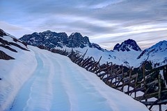 Morning blues in the Swiss Alps (PeterThoeny) Tags: schuders switzerland mountain fence woodfence alps snow day dawn sunrise sky cloud cloudy outdoor graubünden grisons landscape 3xp raw nex6 photomatix selp1650 hdr qualityhdr qualityhdrphotography fav200