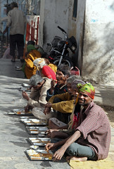 Feeding the Poor (cowyeow) Tags: poverty street charity travel food india temple worship feeding eating indian traditional faith religion poor culture belief muni jain rajasthan udaipur indianfood needy jainism