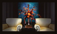 Floral de l'Automne (John Jardin) Tags: flowers blue autumn light orange fall floral golden design shadows chairs interior dramatic exotic vase blooms elegant drama decor