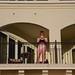 Girl Taking Photos On The Balcony