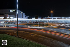 The super highway to Elvesville (alundisleyimages@gmail.com) Tags: newbrighton wirral merseyside england uk night longexposure christmaslights traffic lighttrails landscape road shops thelightcinema grass roundabout transport seasonal starbucks christmastree