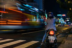 Waiting for the Bus (Linus Wärn) Tags: asia neon neonlights taiwan kaohsiung nightphotography nightlights traffic streetphotography street moped scooter lightstreaks traffictrails crossing helmet
