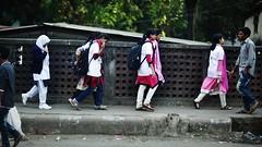 Migratory Birds (N A Y E E M) Tags: girls students pedestrians friday afternoon street ornizamroad chittagong bangladesh carwindow widescreen 16x9