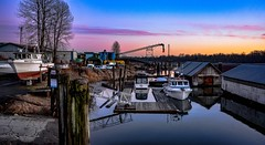 Christie by the River :) (Images by Christie ♪♫ Happy Clicks for 2017 !) Tags: fraserriver kanakalanding river industry boatramp sundown sunset boat boats moored mooring sawdustmill boathouse nethouse dock ramp reflections water bc britishcolumbia canada fishboat sky clouds lumbermill drydock