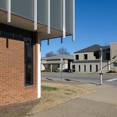 Loved these vertical downward protrusions! (Tim Kiser) Tags: 2016 20160103 7thandfrederica bresciauniversity daviesscounty daviesscountykentucky fredericastreet fredericaand7th fredericaandseventh img8087 january january2016 kentucky lechnergraduatecenter owensboro owensborokentucky seventhandfrederica west7thstreet westseventhstreet williamhthompsonschoolofbusiness architecturaldecoration architecturalornamentation brickwall browngrass buildingcorner buildings cloudlesssky collegebuilding corner downtown downtownowensboro downwardprotrusions grass intersection lawn mowedarea mowedgrass mulch paved pavement pedestriansignal sidewalk street streetintersection sunny tallwindow turfgrass verticalornamentation walksignal weeds westkentucky westernkentucky unitedstates us
