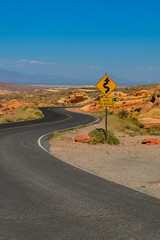 Motion Sickness Ahead (Marximator) Tags: road travel blue orange usa valleyoffire sign photo nikon desert nevada curves roadtrip route panneau virages beginnerdigitalphotographychallengewinner d3100