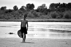 DSC_0180 (Travis Schuldt) Tags: blackandwhite beach water monochrome sport washington seaside sand outdoor pacificnorthwest pnw skimboarding bnw skimboard skimming