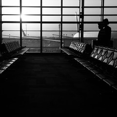 At the Airport (arondphotography) Tags: light shadow blackandwhite sun silhouette airplane fly blackwhite airport gate shadows sony minimalism stewardess doha a290 quatar