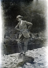 Man posing on a rock 20s (vintage ladies) Tags: portrait people blackandwhite man hat socks vintage pose stream posing tie suit 20s portriat 20sman