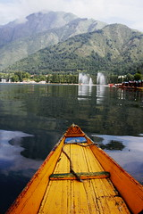 Yellow Boat in Dal Lake, Srinagar (surbhibharadwaj1998) Tags: sky india mountain lake reflection water yellow boat dal kashmir srinagar