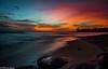 Evening Delight!! (Doreen Bequary) Tags: poipukauai poipubeach kauai hawaii beach longexposure bigstopper rock sunset clouds surf ocean orange pink landscape seaside shore sky cpid coast water cloud d500