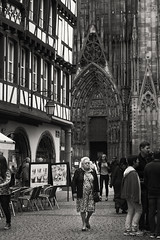 All the lonely people ... (lunaryuna) Tags: france lalsace strasbourg placedelacathédrale cathedral buildings architecture streetphoto solitude aloneinamultitude standingkneedeepinariverdyingofthirst historiccitycentre people tourism crowd aloneinthecrowd monochrome blackwhite bw walkinthecity homourbe lunaryuna