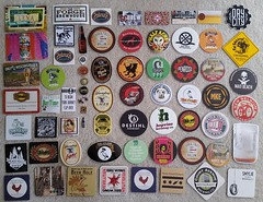 beer swag collection (happily Evan after) Tags: beer swag breweries brewery sticker coaster pin pinback tattoo postcard business card magnet bottle collection guitar pick ironon patch