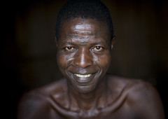 Benin, West Africa, Onigbolo Isaba, holi tribe man covered with traditional facial tattoos and scars portrait (Eric Lafforgue) Tags: africa portrait people color male men face smiling horizontal closeup tattoo skinny adult african culture documentary lifestyle tribal tattoos westafrica benin copyspace tradition tribe ethnic holi facial anthropology scarification oneperson indigenous headandshoulders tattooed darkbackground onemanonly colourimage africanethnicity 1people   oneadultonly   onigboloisaba benin1850