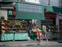 Green girl in a green corner ( explored ) (Alain Dutertre) Tags: streetphotography france xe2 montmartre shop 35mm fujinon paris epicerie vegetable fuji women green fuginon europe 14 xf