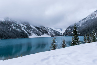 Winter Scene: Snow, Water, Mountains and fog.