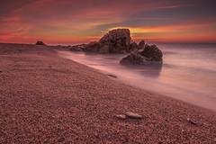 Golden sunrise (II) (eztopo79) Tags: sea seascape beach playa platja sant pol mar barcelona mediterranean mediterrani rocks sun sunrise canon catalonia catalunya tokina formatt hitech maresme